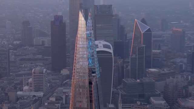 fourth week of 'clap for our carers' air views england london top of the shard lit up blue in tribute to the nhs / tower 42 with illuminated sign on... - blue background stock videos & royalty-free footage