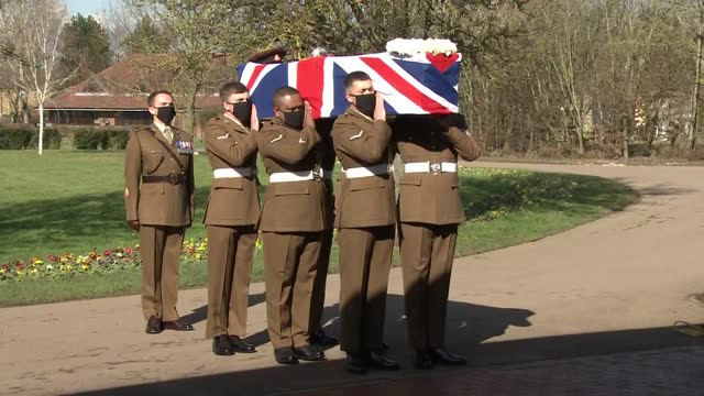 funeral of captain sir tom moore held in bedford: funeral service; england: bedfordshire: bedford: bedford crematorium: ext hearse carrying the... - war and conflict video stock e b–roll
