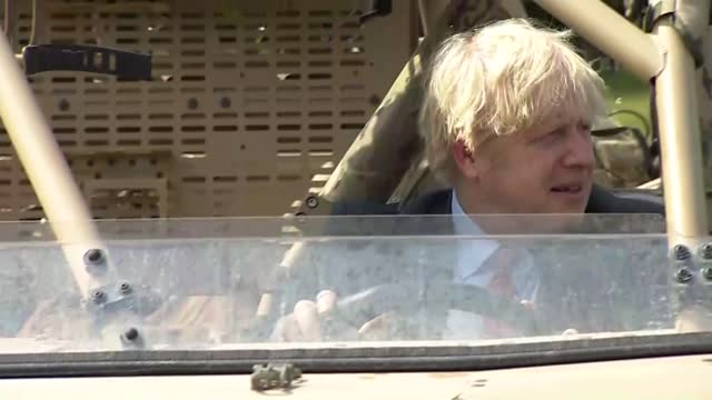 government expected to add more countries to travel green list; england: hampshire: aldershot barracks: ext various shots of boris johnson and seated... - add list stock videos & royalty-free footage