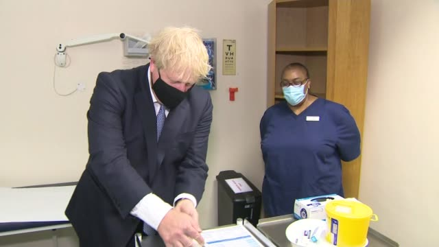 government expected to announce junk food advertising ban in effort to tackle obesity england east london int boris johnson mp along corridor of gp... - hand weight stock videos & royalty-free footage