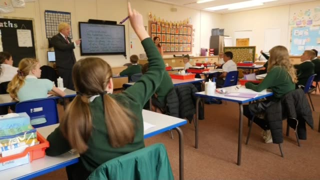 government plans for all children to be back at school full-time by september; england: hertfordshire: hemel hempstead: bovingdon primary academy:... - school child stock videos & royalty-free footage