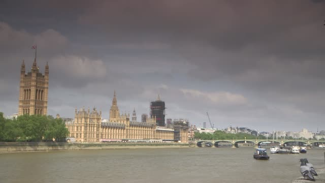 stockvideo's en b-roll-footage met government says it is safe for schools to reopen in june; england: london: westminster: police officers away as patrolling wide shot westminster... - greater london