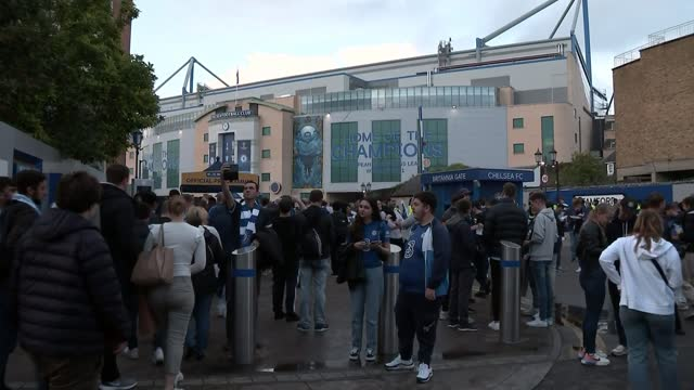 government sets out covid plan for the winter; england: london: fulham: ext various shots of chelsea fc fans arriving at stamford bridge stadium vox... - politics stock videos & royalty-free footage