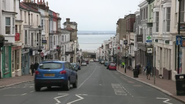 government to trial track and trace app on the isle of wight; england: isle of wight: ext gv high street and cars away down road long shot hovercraft... - amphibious vehicle stock videos & royalty-free footage