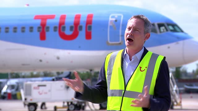 grant shapps announces countries on the government's green list for travel; england: bedfordshire: london luton airport: ext reporter to camera sot... - spraying stock videos & royalty-free footage