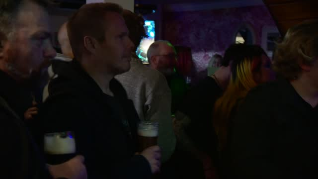 guernsey drinkers enjoy a saturday night at the pub as rest of uk looks on with envy; guernsey: int band performing on stage in busy pub various of... - channel islands england stock videos & royalty-free footage