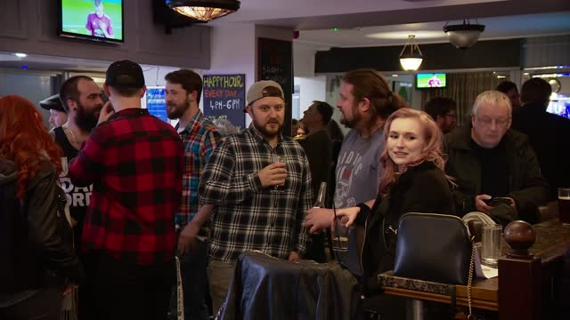 guernsey drinkers enjoy a saturday night at the pub as rest of uk looks on with envy; guernsey: int various of people standing chatting and drinking... - channel islands england stock videos & royalty-free footage