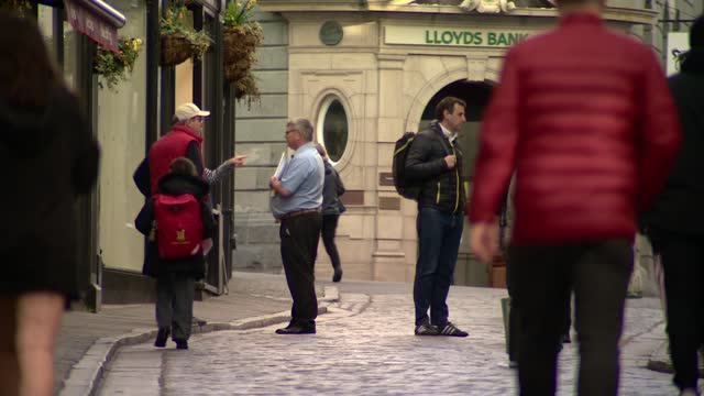 guernsey sees nearly all lockdown restrictions lifted; guernsey: ext various shots of people along high street. - guernsey stock videos & royalty-free footage