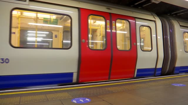 gvs dlr / london underground / emirates cable car; england: london: mile end: int various of trains at station bow road: int train people riding on... - pulling stock videos & royalty-free footage