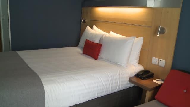 gvs empty holiday inn hotel; england: london: tower hamlets: limehouse: holiday inn express london - limehouse: int gvs holiday inn hotel room /... - hotel stock videos & royalty-free footage