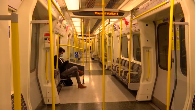 gvs empty london trains and tube stations during eased lockdown; england: london: int various shots of almost-empty london underground tube train as... - indoors stock videos & royalty-free footage