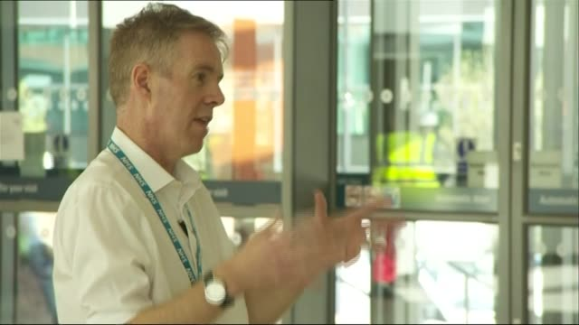 gvs nhs nightingale north west under construction; england: greater manchester: manchester: g-mex : int journalist interviewing official - at... - nightingale stock videos & royalty-free footage