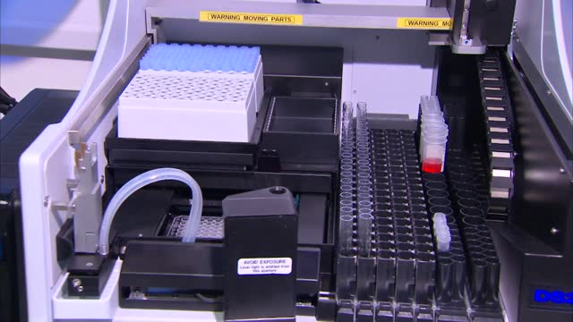 gvs of biobank uk testing lab; england: cambridgeshire: cambridge: int gvs lab worker turning on mixer and placing test tube inside before depositing... - epidemiology stock videos & royalty-free footage