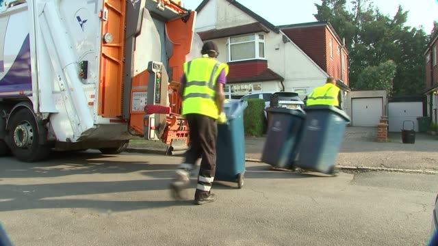 gvs waste collection in harrow, london; filmed england: london: harrow: ext bin lorry arriving / refuse collectors loading wheelie bins into truck /... - bin stock videos & royalty-free footage
