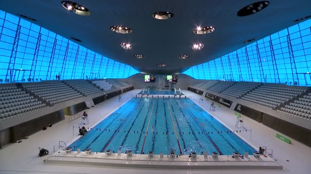 gyms and leisure centres reopen london aquatics centre england london olympic park london aquatics centre int side view pool and swimmers along down... - tilt stock videos & royalty-free footage
