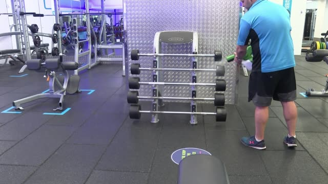 gyms pools and beauty salons to reopen in england following lockdown england south london int gv gym machine room with hand sanitiser and sign about... - gym stock videos & royalty-free footage