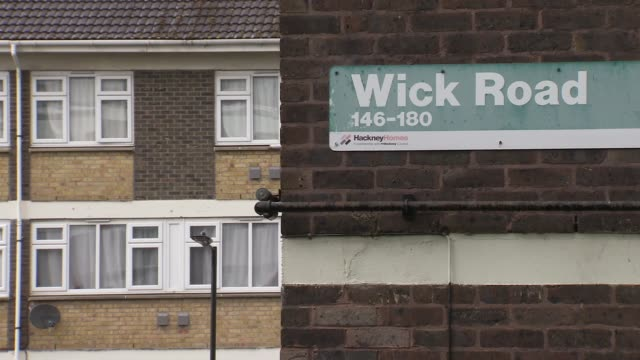 hackney social housing gvs; england: london: hackney: ext / heavy rain low angle view block of flats and utility pole and telephone lines in... - flat stock videos & royalty-free footage