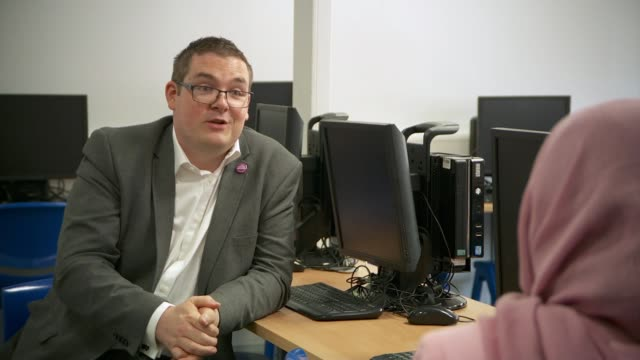 half of schools have not received laptops for disadvantaged pupils; england: northamptonshire: raunds: manor school sports college: int chris bateman... - northamptonshire stock-videos und b-roll-filmmaterial