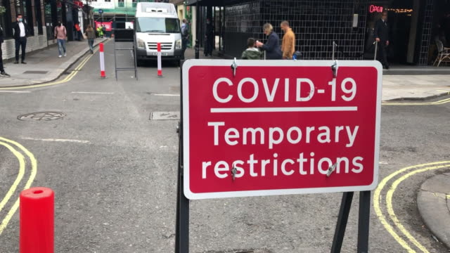 coronavirus hand washing stations and warning signs in london - road sign stock videos & royalty-free footage