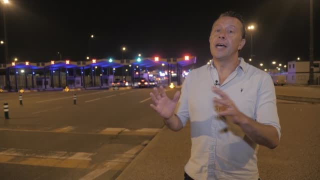 holiday makers rush to leave france as quarantine comes into effect france calais various shots ferry along out of harbour pan car along past man in... - b rolle stock-videos und b-roll-filmmaterial