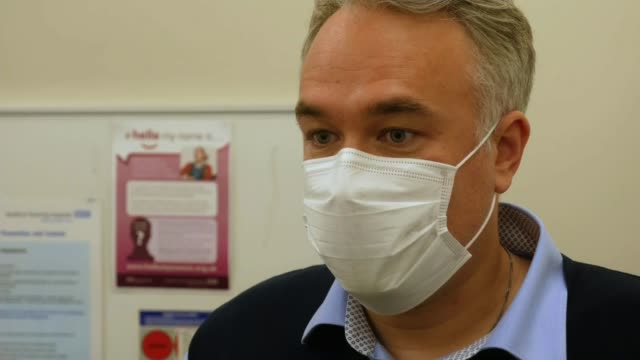 hospitals across north of england struggle with second wave of infection; england: west yorkshire: bradford royal infirmary: three hospital staff... - respiratory equipment stock videos & royalty-free footage