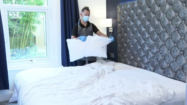 hotel and guest house owners using hygiene accreditation schemes to reassure customers; england: devon: torquay: ext various shots of ocean, paddle... - chores stock videos & royalty-free footage