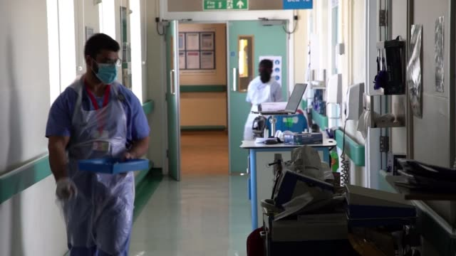 how epsom and st helier university hospitals nhs trust is fighting the disease; england: london: carshalton: st helier hospital: int nhs staff along... - corridor stock videos & royalty-free footage