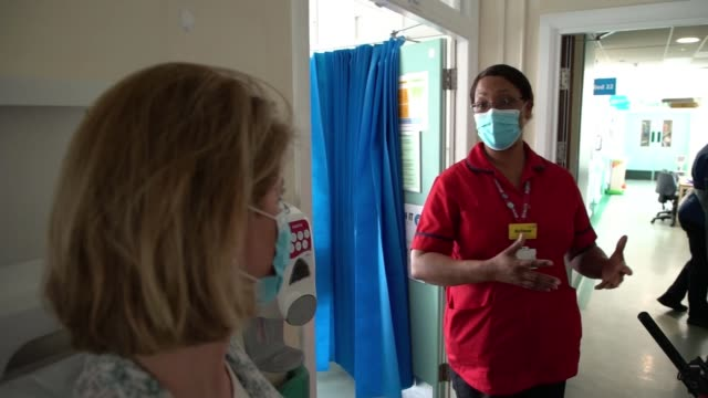 how epsom and st helier university hospitals nhs trust is fighting the disease; england: london: carshalton: st helier hospital: int arlene wellman... - corridor stock videos & royalty-free footage