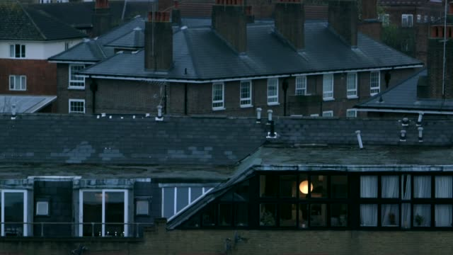 stockvideo's en b-roll-footage met how to cope with isolation england london ext day /at various shots of buildings and city scenes including flats and trains along terry waite... - terry waite