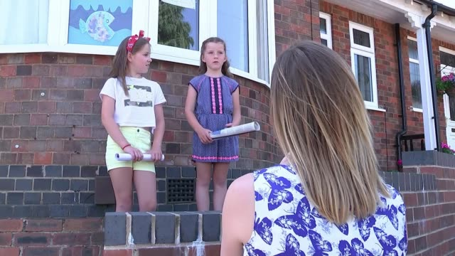 'in this together' sisters aged 6 and 9 edit weekly newspaper to cheer up neighbours england derbyshire derby ext various of young sisters imogen... - newspaper stock videos & royalty-free footage