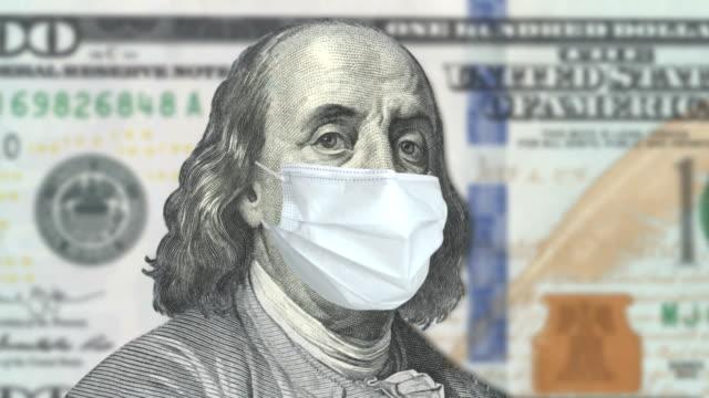 covid-19 coronavirus in usa, 100 dollar money bill with face mask - american one hundred dollar bill stock videos & royalty-free footage