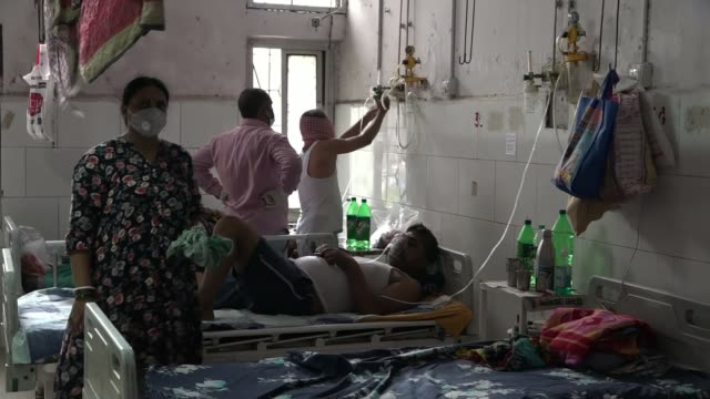 india has world's third highest case load: view from bihar; india: bihar: ext tilt down cracks in ceiling of hospital and people gathering and... - man and machine stock videos & royalty-free footage