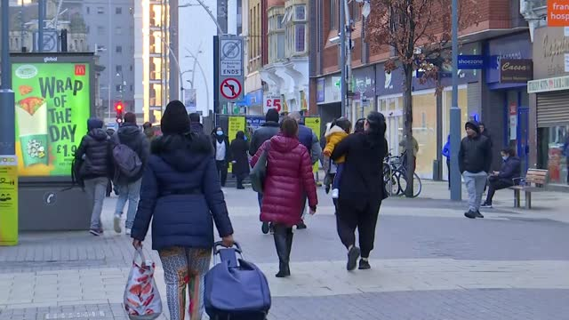 infection rate starting to go down in most london boroughs; england: london: ext various shots of people along street past shops - face down stock videos & royalty-free footage