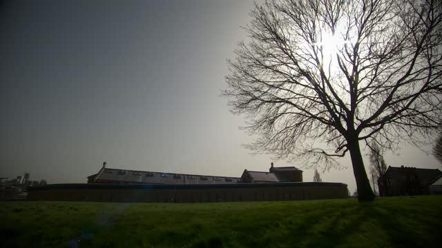 inmates' mental health damaged by prison lockdowns; england: nottinghamshire: nottingham: hmp nottingham : general views of prison exteriors... - prison stock videos & royalty-free footage