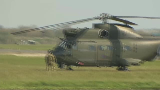 stockvideo's en b-roll-footage met joint helicopter command rehearses casualty transport england hampshire thruxton aerodrome ext various of military helicopters as they take off and... - hampshire engeland