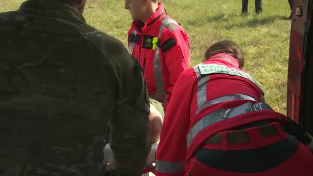 joint helicopter command rehearses casualty transport england hampshire thruxton aerodrome soldier on stretcher lifted into helicopter by paramedics... - news not politics stock videos & royalty-free footage