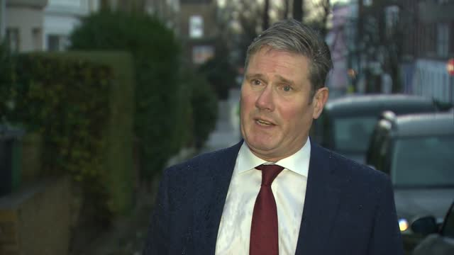 keir starmer interview; england: london: ext / raining heavily sir keir starmer mp interview sot. q: on the vaccine roll out so far. how satisfied... - satisfaction stock videos & royalty-free footage