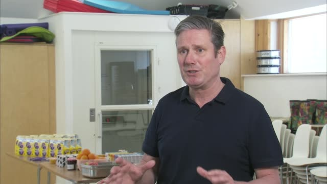keir starmer visits food distribution point england london camden int sir keir starmer mp interview sot q on whether enough is being done to protect... - delivering stock videos & royalty-free footage