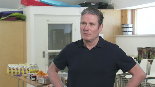 keir starmer visits food distribution point; england: london: camden: int sir keir starmer mp interview sot q: about those in small flats without... - home interior stock videos & royalty-free footage