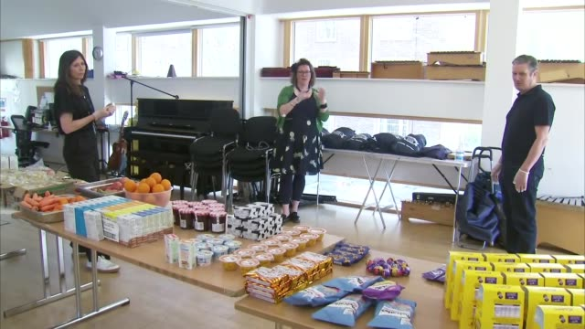 keir starmer visits food distribution point; england: london: camden: int sir keir starmer mp talking to people at food distribution point set up in... - keir starmer stock videos & royalty-free footage