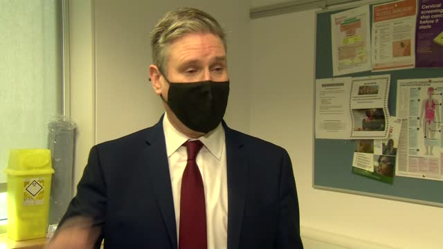 keir starmer visits vaccination centre; england: london: stratford: int sir keir starmer mp interview sot. q: reaction to events in us- storming of... - office politics stock videos & royalty-free footage