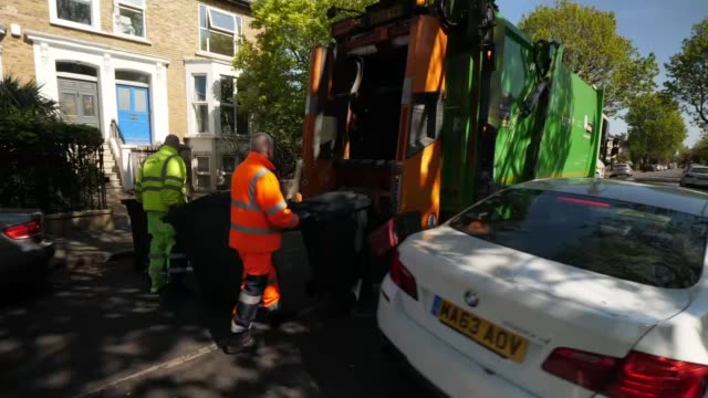 key workers praised for working through the pandemic; england: london: ealing: int truck sean and other waste collector travelling in lorry ext... - heavy goods vehicle stock videos & royalty-free footage
