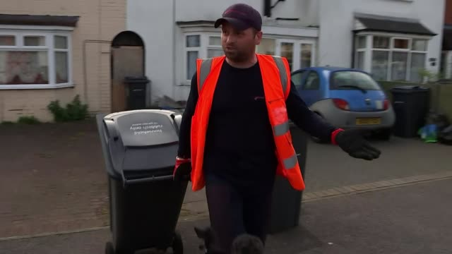 key workers speak out about the public's appreciation; england: birmingham: ext refuse collector along with wheelie bin wheelie bin emptied into bin... - bin stock videos & royalty-free footage