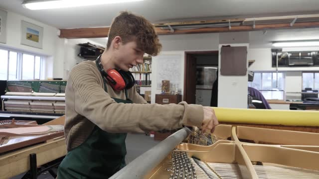 last traditional piano maker in britain enjoys boost in sales; england: yorkshire dales: int various close shots of piano while being played sot... - jamie cullum stock videos & royalty-free footage