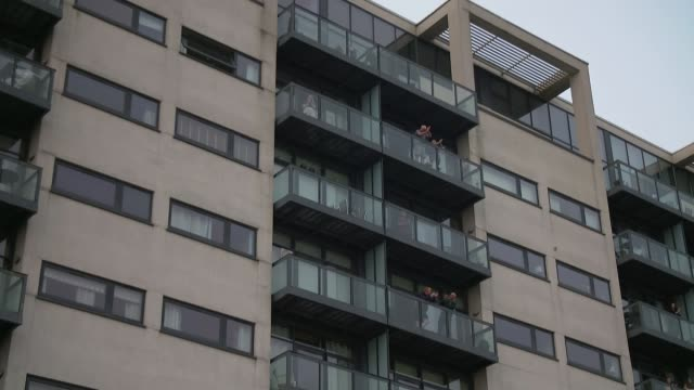 latest 'clap for carers' event held around the country; scotland: glasgow: ext people clapping and banging pots and pans on balcony of housing block... - cooking pan stock videos & royalty-free footage
