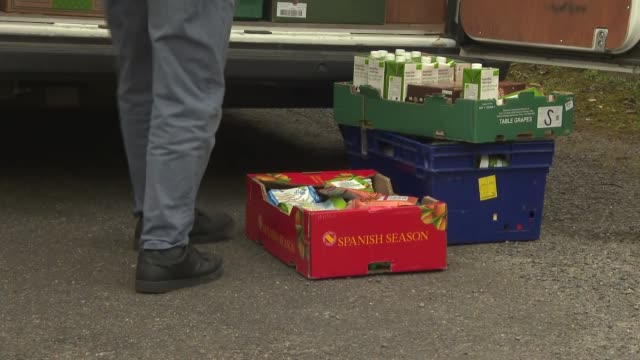 lincoln foodbank england lincolnshire lincoln lincoln foodbank ext various of man stacking food boxes in back of lincoln foodbank van/ boxes of food... - lincolnshire stock videos & royalty-free footage