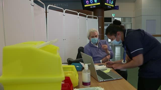 lionel blair receives covid-19 vaccine; england: surrey: epsom / leatherhead: int lionel blair receiving covid-19 coronavirus vaccination injection... - lionel blair stock videos & royalty-free footage