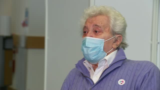lionel blair receives vaccination as centre opens at epsom racecourse; england: surrey: epsom racecourse: int lionel blair interview sot - lionel blair stock videos & royalty-free footage