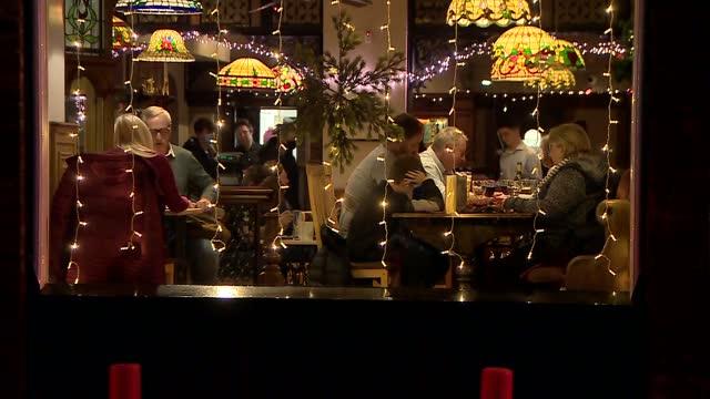 liverpool gvs as lockdown lifted; england: merseyside: liverpool: lark lane: ext / night gvs lark lane restaurants and diners seen eating inside - night stock videos & royalty-free footage