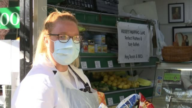 local butchers and greengrocers busier due to lockdown uk england london various shots of husseys grocery store serving customers from doorway... - vegetable stock videos & royalty-free footage
